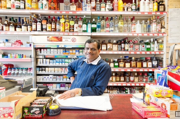 portrait-of-indian-off-licence-owner-london-england-uk-E5J1F5